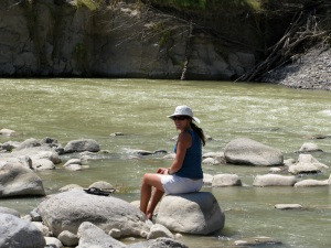 Caro dipping her feet in the Rio Grande.